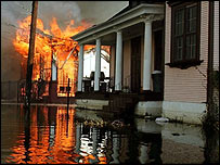 House burns in New Orleans as flooded streets hamper fire-fighters