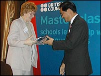 Grange head presents cheque to Thai education vice-minister