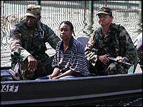A woman is evacuated from New Orleans