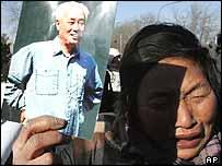 Mourner outside Babaoshan cemetery in Beijing