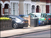 Cars parked in front gardens
