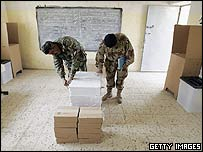 Iraqi security forces set up a polling station in Ramadi