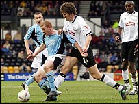 Derby's Grzegorz Rasiak (r) challenges Fulham's Mark Pembridge