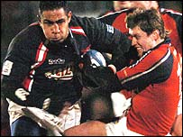 Scarlets centre Salesi Finau breaks through Ronan O'Gara's attempted tackle