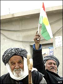 A man waves a Kurdish flag in Irbil, Iraq