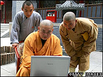 Shi Yongxin, abbot of the Shaolin Temple, works on the computer April 8, 2005 in Dengfeng, Henan Province, China.