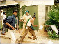 Farmers storming a building in 2003 formerly used by Monsanto