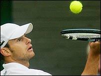 Andy Roddick tries his racquet