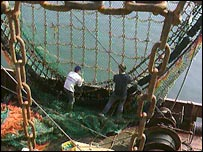 Trawlermen with large nets and other fishing gear