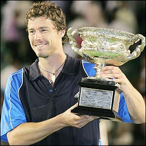 Safin poses with the Australian Open trophy after defeating Lleyton Hewitt