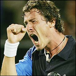 Safin celebrates his second Grand Slam win as he beats Lleyton Hewitt