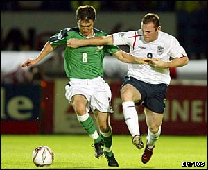 Wayne Rooney charges around the pitch and tussles with Damien Johnson
