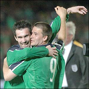 Keith Gillespie and David Healy celebrate beating England