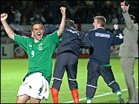 Scorer David Healy and the NI coaching staff celebrate at the final whistle