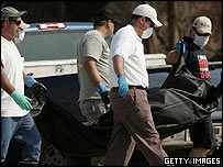 A body is recovered after Hurricane Katrina