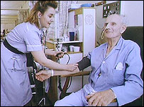 Patient having blood pressure checked