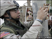 US soldier posts election material in Iraq