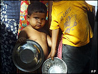 Sri Lankan child waits for food in a camp for tsunami survivors