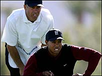 Steve Williams (left) and Tiger Woods