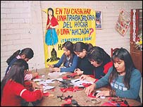 Peruvian domestic workers take part in an arts and crafts workshop