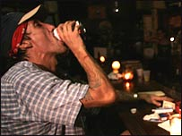 A man in a candlelit bar in New Orleans