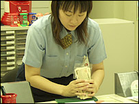 Worker at post office in Onomichi
