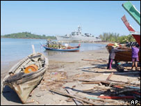 Thai fishermen repair their boats