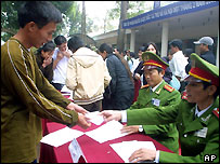 Nguyen Van Nam, 37, signs papers for his release from jail during a government amnesty, 31 Jan
