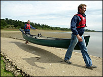 Men carrying a kayak