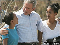 George W Bush comforts Kim (left) and Bronwynne Bassier, who lost their home in Biloxi, Mississippi