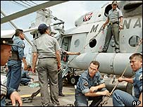 Navy personnel on board a relief ship waiting to head the US