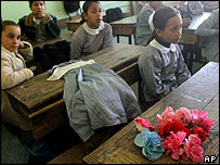Classmates placed a plastic bouquet at empty desk of Palestinian schoolgirl killed this morning