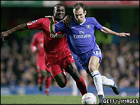 Olivier Tebily of Birmingham (left),  and Arjen Robben of Chelsea