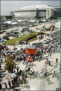 Displaced people queue for relief debit cards in Houston, Texas