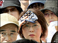 People listen to a speech by Japan's Prime Minister Junichiro Koizumi, Aug. 30, 2005