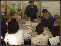 School children with teacher in classroom