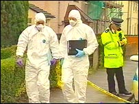 Picture of forensic scientists at the murder scene