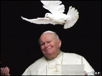 Pope John Paul II releases a dove at the end of prayers on 30 January 2005