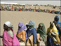 Darfur refugees line up for food in January 2005