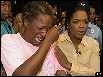 Oprah Winfrey visits evacuees at the Houston Astrodome