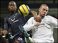 Spurs' Anthony Gardner (left) tussles with Bolton's Kevin Nolan