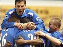 Portsmouth players congratulate Yakubu after his winner