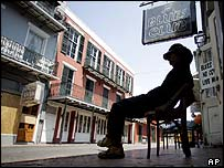 A man sits outside a bar in New Orleans' French Quarter