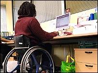 A wheelchair user at a computer terminal