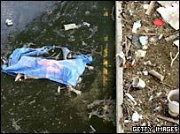 A body lies among debris in a New Orleans street (9 September 2005)