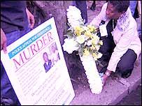 Cheryl Sealey lays a wreath on Harrow Rd
