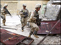 US troops approach a house to search for insurgents in Talafar