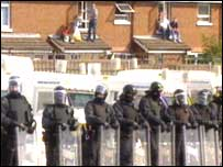 Riot police kept residents and marchers apart