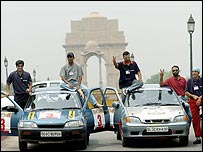 Competitors on the Indian Desert Storm rally, posing in front of India Gate in New Dehli
