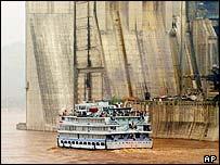 Boat sailing past Three Gorges Dam